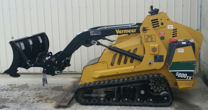 Loader, compact utility  Push blade attachment with hyd. angle